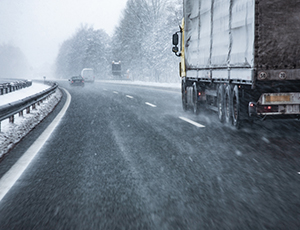 Truck driving on winter weather highway
